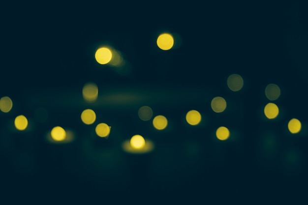 Defocused yellow bokeh lights on dark background
