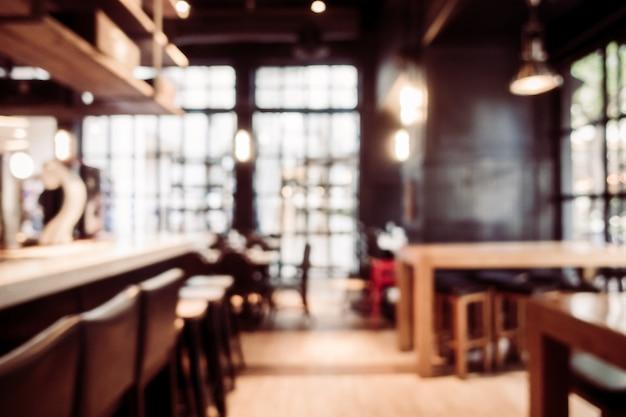 抽象的なぼかしとdefocusedレストランと喫茶店のカフェのインテリア