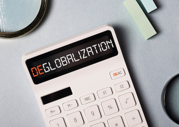Deglobalization in business and commerse concept. word on calculator about anti globalism, reverse globalization.