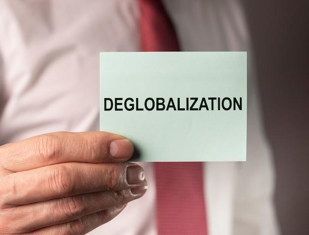 ビジネスと商業の概念における脱グローバル化の概念。反グローバリズム、逆グローバリゼーションに関する単語テキスト。
