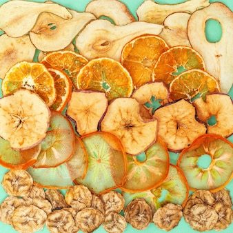 Dehydrated fruit chips of apple, banana, persimmon, tangerine, pear, trendy food for vegetarian