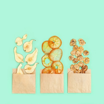 Dehydrated fruit chips of banana, persimmon, pear in paper package.