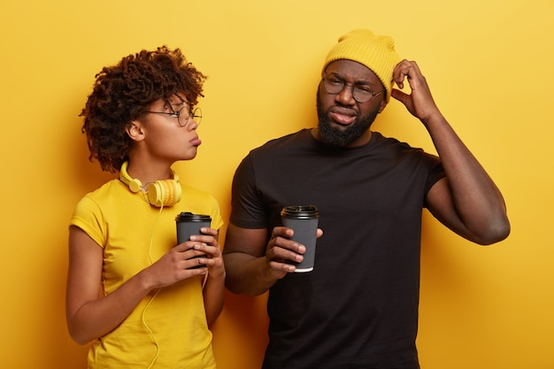 Dejected unshaven man with black skin tells about his problem to close friend