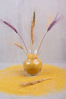 Delcious yellow vermicelli with vase of wheats .