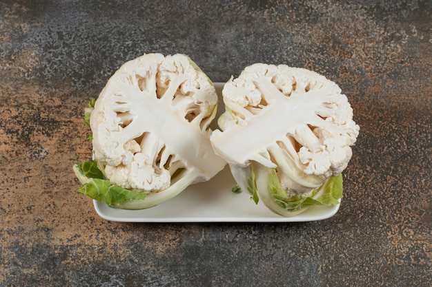 Delectable sliced cauliflower in the bowl , on the marble surface