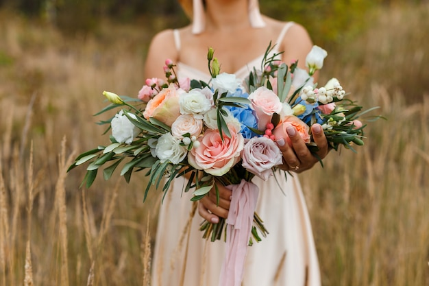 A delicate and beautiful wedding bouquet of flowers.