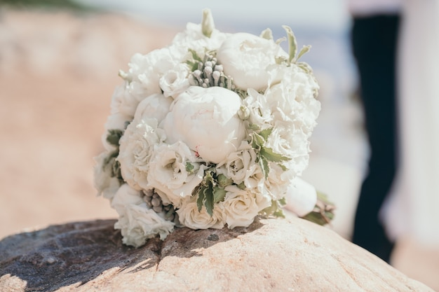 Delicate bouquet of the bride with peonies and roses closeup wedding bouquet bush roses in the bride...