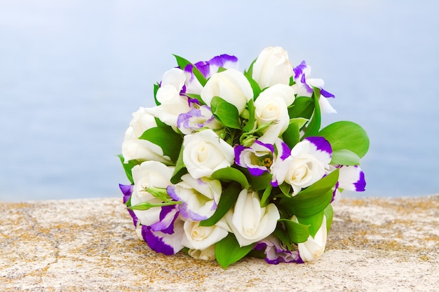 Delicate bridal bouquet of purple eustomas and white roses
