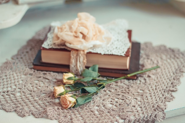 Delicate composition with old books decorated in rustic style