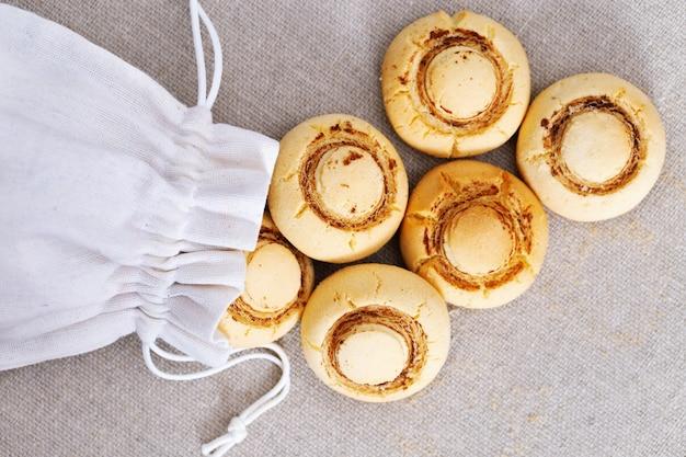 Delicate crispy cookies in form of mushrooms.