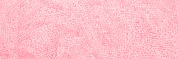Delicate crumpled fabric, small square texture banner of beautiful pink color