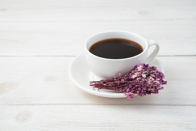 Delicate festive background with coffee and flowers on a white background. side view.