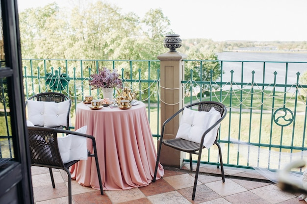 Delicate morning tea table setting with lilac flowers in nesvizh castle