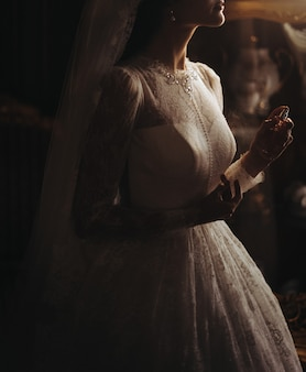 Delicate pearls on bride's beautiful dress