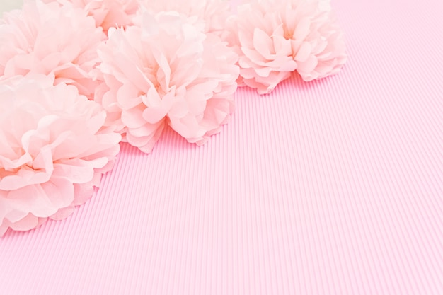 Delicate pink background mock up with paper peonies and place for text.
