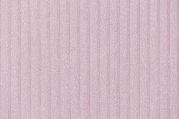 Нежный розовый, ню плиссе фон. геометрические линии ткани. ткань, текстиль крупным планом.
