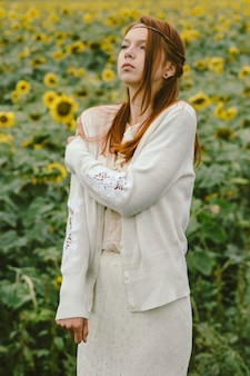 Delicate portrait of a red-haired girl dressed in a vintage style