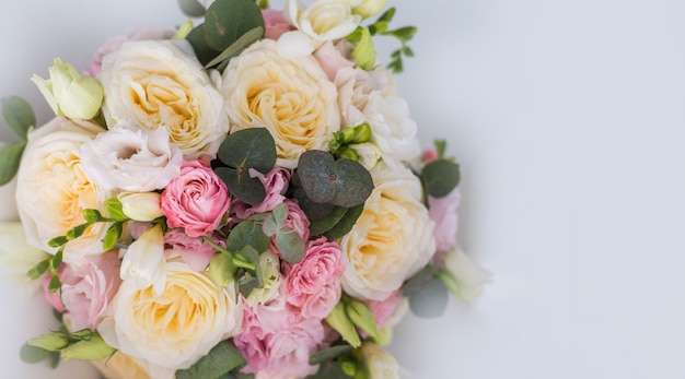 The delicate rustic floral bouquet on grey background