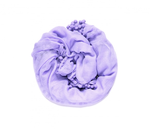 Delicate, soft and crumpled twisted in a circle fabric of purple color is isolated