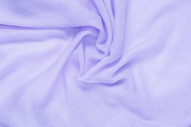 Delicate soft and wrinkled fabric purple color background texture