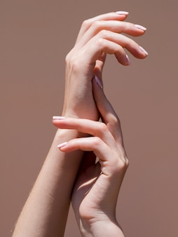 Delicate woman's hands in the spotlight