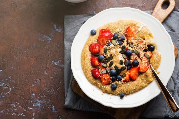 Delicious amaranth topped with almond butter