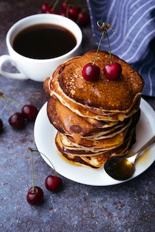 Delicious american pancakes with cherry on top