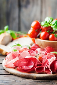 Delicious antipasto with ham and bresaola