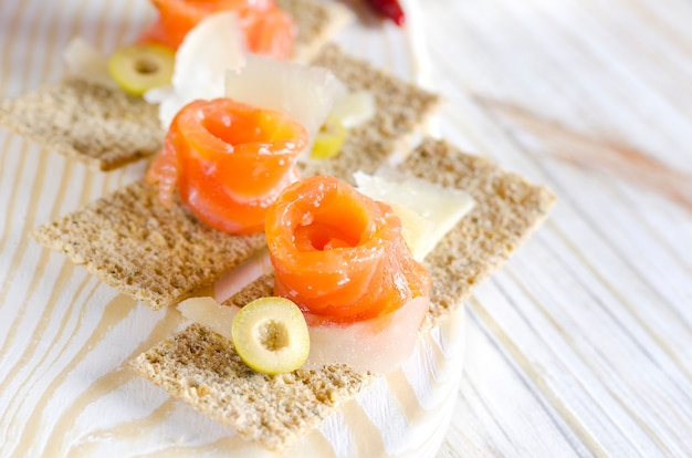 Delicious appetizer canapes with salmon and cheese