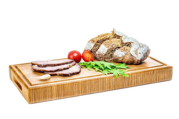 Delicious appetizers for wine or a snack - prosciutto, figs, bread, cheese on a rustic wooden cutting board