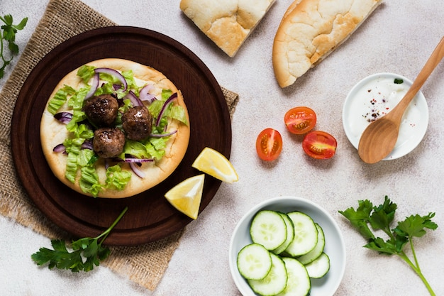 Delicious arabic fast-food meat rolls and veggies