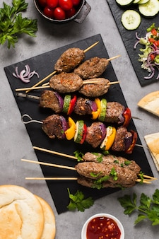 Delicious arabic fast-food meat on skewers high view
