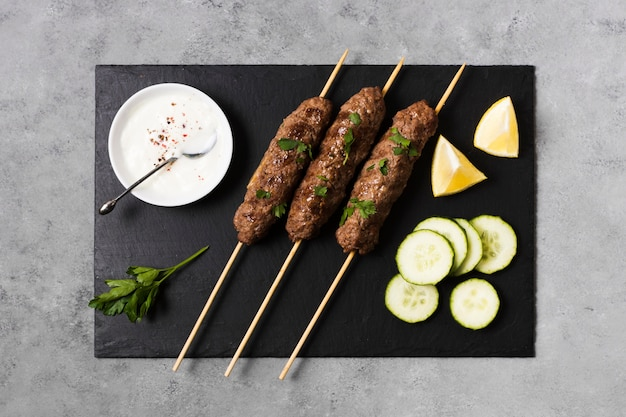 Delicious arabic fast-food skewers and slices of cucumber