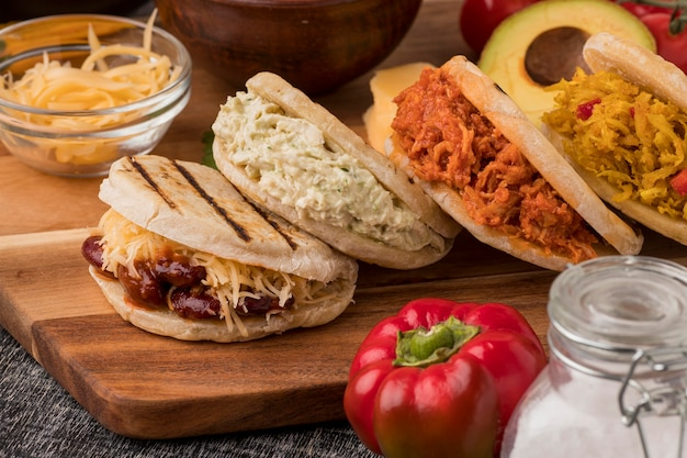 Delicious arepas on wooden board
