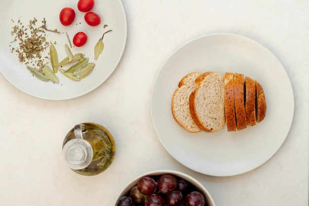 Delicious arrangement with bread and olive oil
