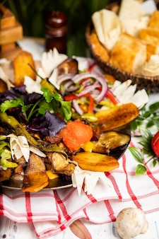 The delicious assorted of meat and vegetables. sac ici - azerbaijan food. meat saute