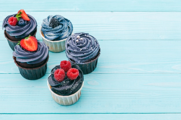 Delicious assortment of beautiful cupcakes close up