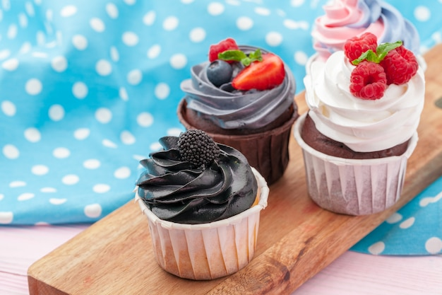 Delicious assortment of beautiful cupcakes, close up
