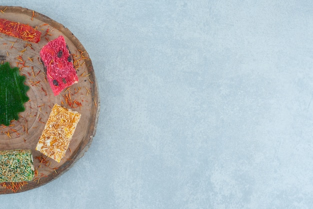 Delicious assortment of turkish delights on the board,on the marble background. high quality photo