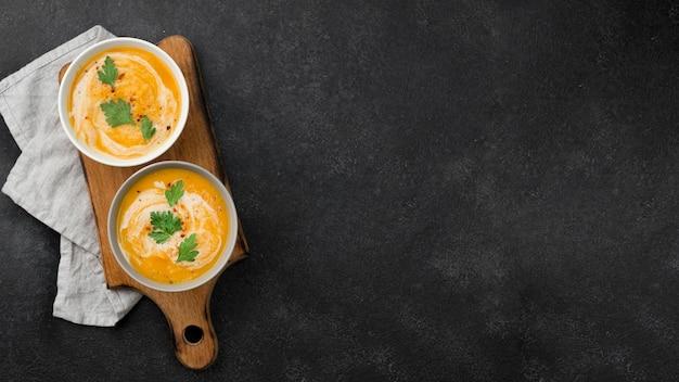 Delicious autumn soup assortment with copy space