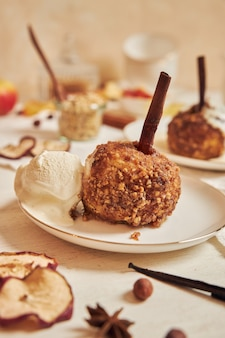 Delicious baked apple with nuts and cinnamon for christmas on a white table