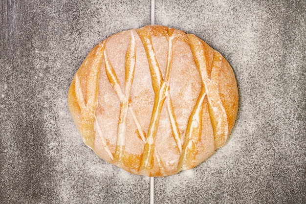 Delicious baked bread with flour on it
