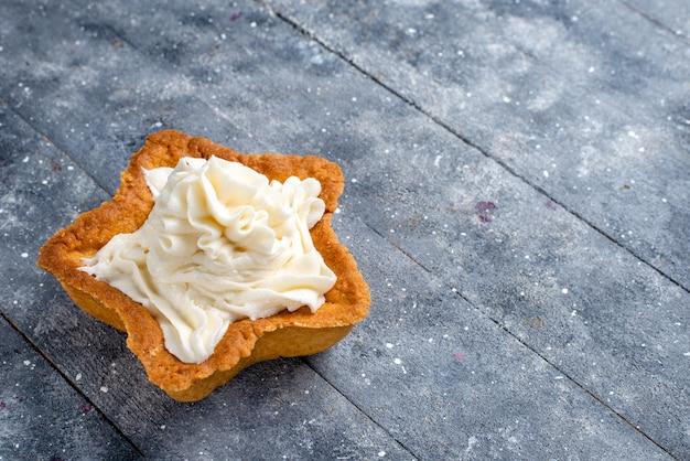 Delicious baked cake star shaped with white yummy cream inside on light desk, cake bake sugar sweet cream tea
