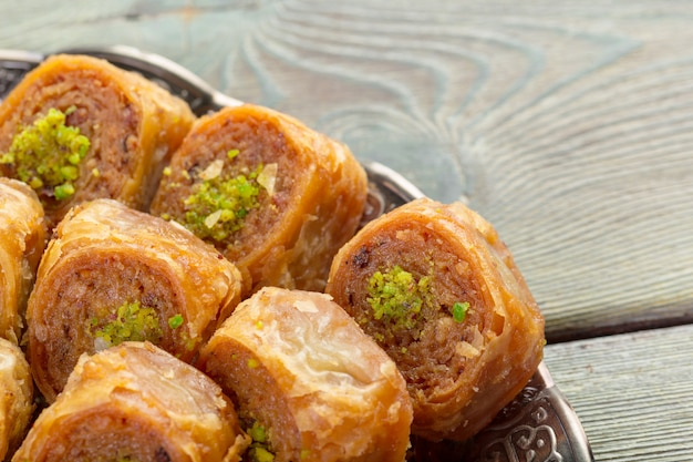 Delicious baklava dessert in oriental bronze setting close up