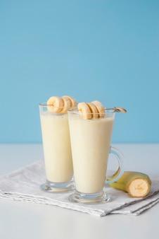 Delicious banana milkshake glasses high angle