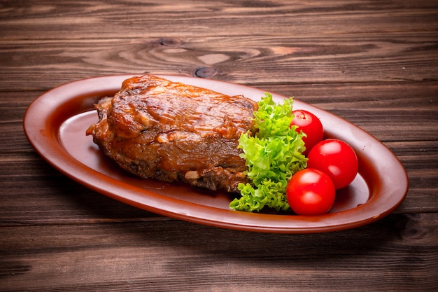 Delicious barbecued ribs seasoned with a spices and fresh herbs