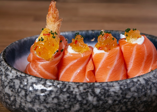 Delicious battered prawn nigiri wrapped with salmon. traditional japanese cuisine.