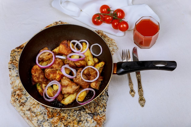 Delicious bbq pork chops with roasted potatoes and onion