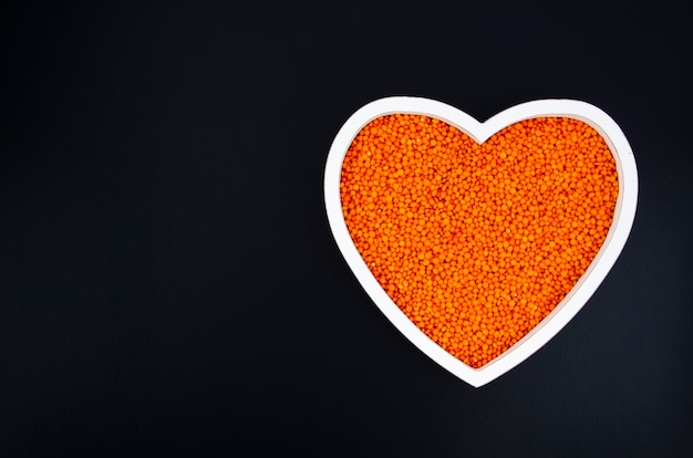 Delicious beans in a heart shaped plate