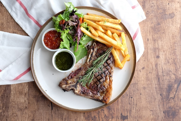 Delicious beef steak with french fries and chilli sauce